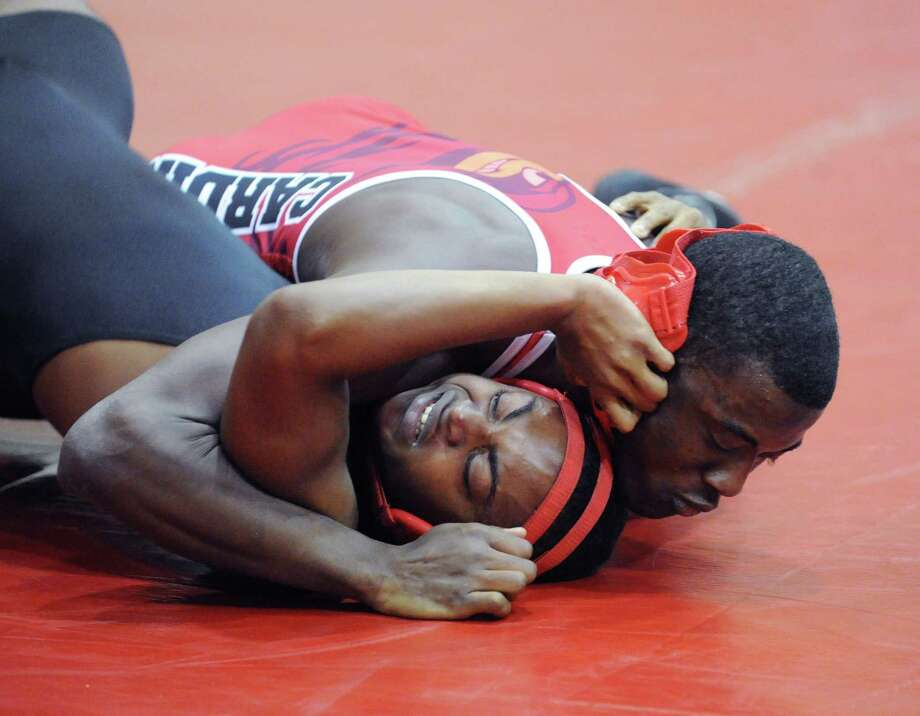 Ray Morris, top, of Greenwich during the 170 pound match agianst Bridgeport Central's Kareem Powell (dark outfit) in high school wrestling match between Greenwich High School and Bridgeport Central High School at Greenwich, Wednesday night, Jan. 23, 2013. Photo: Bob Luckey / Greenwich Time