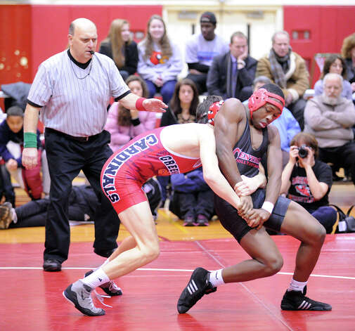 Bridgeport Central's Marcus Moss, right, goes up against Erik Tack, of Greenwich during 152 pound match agianst in high school wrestling match between Greenwich High School and Bridgeport Central High School at Greenwich, Wednesday night, Jan. 23, 2013. Photo: Bob Luckey / Greenwich Time