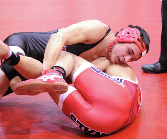 Bridgeport Central's Mike Deramo, top, gets the better of Mike McCaffrey of Greenwich during 145 pound match in high school wrestling match between Greenwich High School and Bridgeport Central High School at Greenwich, Wednesday night, Jan. 23, 2013. Photo: Bob Luckey / Greenwich Time