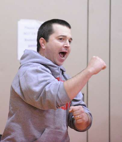 Bridgeport Central wreslting coach Christian Upright reacts during the high school wrestling match between Greenwich High School and Bridgeport Central High School at Greenwich, Wednesday night, Jan. 23, 2013. Photo: Bob Luckey / Greenwich Time