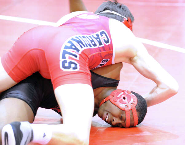 Erik Tack, top, of Greenwich, during 152 pound match agianst Bridgeport Central's Marcus Moss (dark outfit) in high school wrestling match between Greenwich High School and Bridgeport Central High School at Greenwich, Wednesday night, Jan. 23, 2013. Photo: Bob Luckey / Greenwich Time