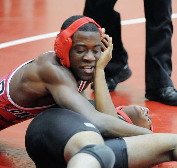 Ray Morris, top, of Greenwich during the 170 pound match agianst Bridgeport Central's Kareem Powell