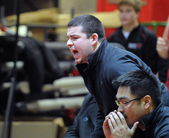 Greenwich wreslting coach George Albano, top, reacts during the high school wrestling match between Greenwich High School and Bridgeport Central High School at Greenwich, Wednesday night, Jan. 23, 2013. Photo: Bob Luckey / Greenwich Time