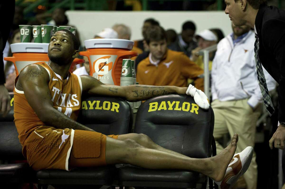 Injuries, such as this one incurred by Julien Lewis, haven't helped the Texas men's cause this season on the court.