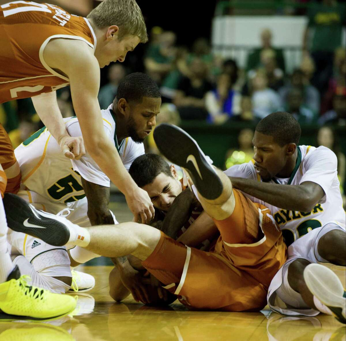 Ioannis Papapetrou (center) and the Longhorns have battled just to be in every game.