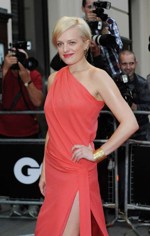 Moss, who plays Peggy on 'Mad Men,' debuted her dramatic blond pixie cut in September of 2012. She's pictured at the GQ 'Men of the Year' awards. Photo: Ben Pruchnie, Getty Images / 2012 Getty Images