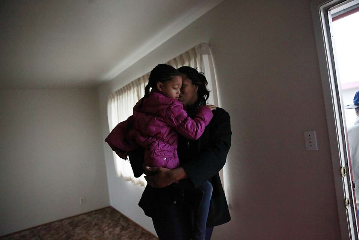 Latifa Lewis (right) and her daughter, Kamil Lewis (left), 5 share a hug as they leave an apartment for rent they had looked at on Wednesday, January 23, 2013 in Hayward, Calif.