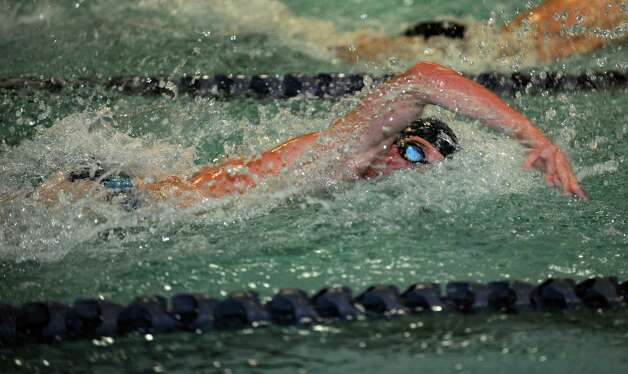 Staples' North Woods competes in the 200 meter freestyle relay race during their meet with West Hill  Wednesday, Jan. 23, 2013 in Westport, Conn. Photo: Autumn Driscoll / Connecticut Post