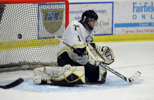 Trumbull's Matthew Paolini fails to stop a St. Joseph shot, during hockey action in Shelton, Conn. on Wednesday January 23, 2013. This shot was slapped in by St. Joseph's #16 Vito Roca. Photo: Christian Abraham / Connecticut Post