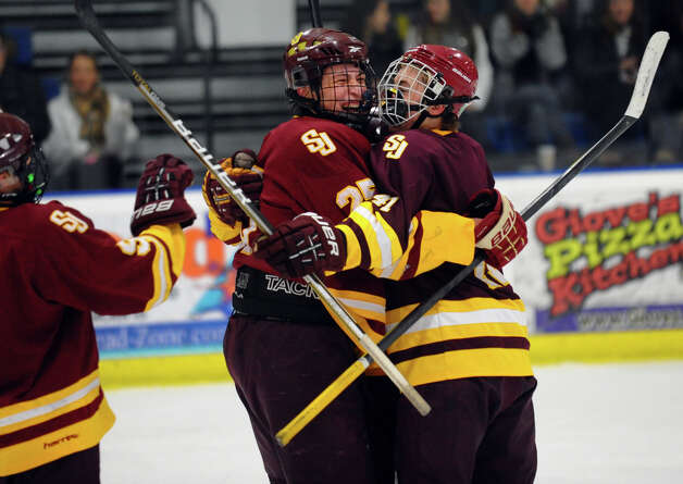 Teammates celebrate a goal by St. Joseph's #16 Vito Roca, during hockey action against Trumbull in Shelton, Conn. on Wednesday January 23, 2013. Photo: Christian Abraham / Connecticut Post