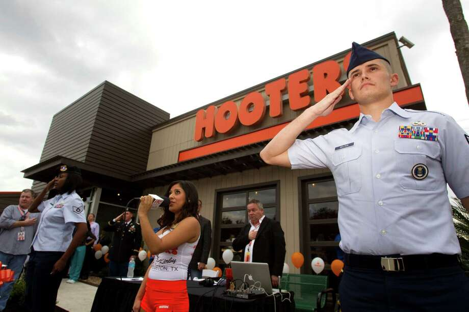 Sammy Jo Marmalejo sings the national anthem at the beginning of the grand re-opening ceremony of the Hooters. Photo: Brett Coomer, Houston Chronicle / © 2013 Houston Chronicle