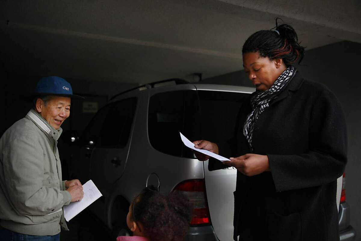 Latifa Lewis (right) takes an application from rental apartment owner Kevin Chou (left) after looking at an apartment for rent on Wednesday, January 23, 2013 in Hayward, Calif.