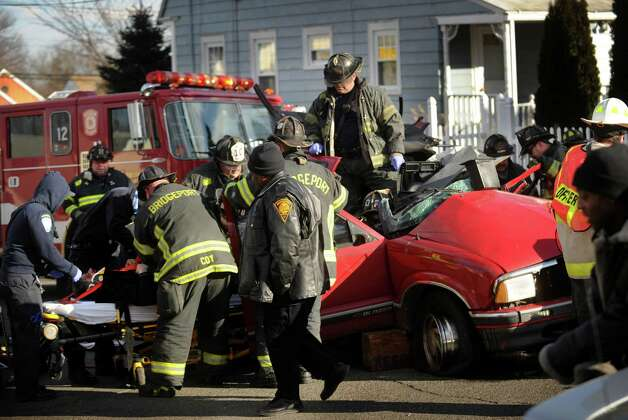 Bridgeport firefighters extricate a driver involved in a serious motor vehicle accident at the intersection of Madison and Burnsford Avenues in Bridgeport on Wednesday, January 23, 2013. Photo: Brian A. Pounds