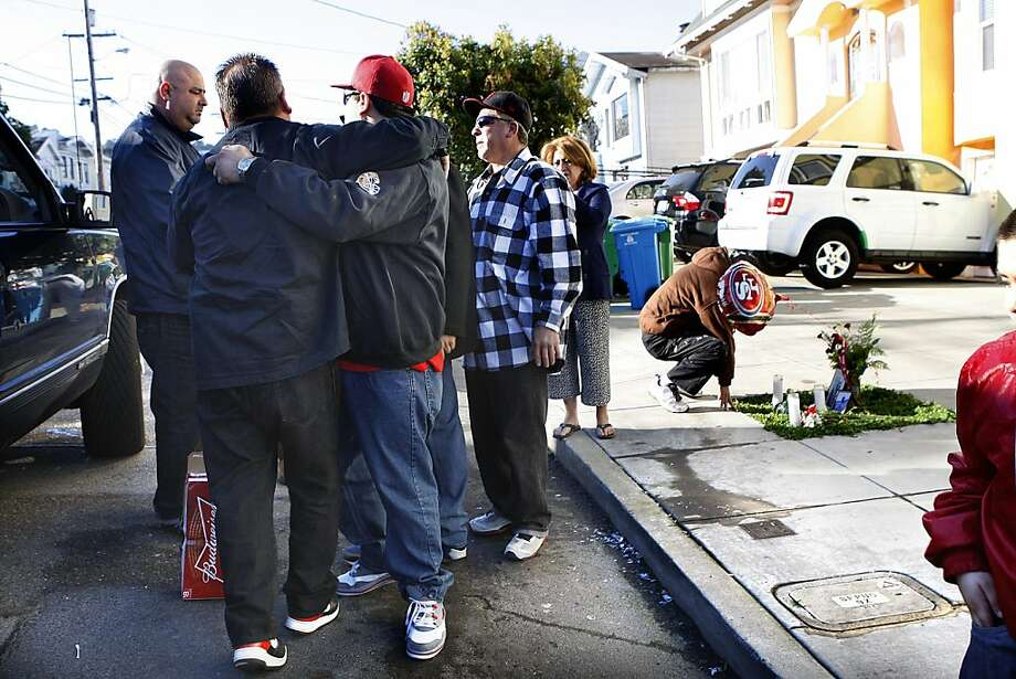 Friends who were with Daniel Colon, 43, yesterday watching the 49er game, visit the memorial where he was shot at 12:05 this morning on the 1100 block of Naples St. in San Francisco, Calif., on Monday, January 21, 2013.  His cousin Andrew Colon, 34, was shot in the chest and taken to SF General hospital. Photo: Liz Hafalia, The Chronicle