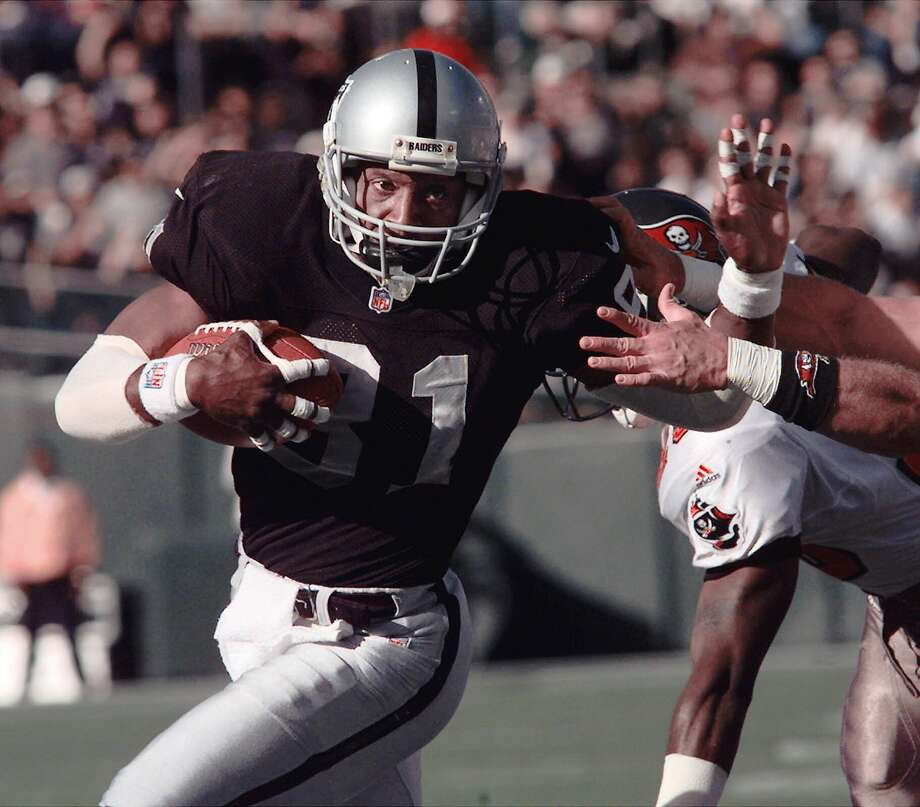 FILE - This Dec. 19, 1999 file photo shows Oakland Raiders wide receiver Tim Brown scoring in the first quarter against the Tampa Bay Buccaneers, in Oakland, Calif. Brown is a finalist for the Pro Football Hall of Fame, the hall announced Friday, Jan. 11, 2013.(AP Photo/Paul Sakuma, File) Photo: Paul Sakuma, Associated Press