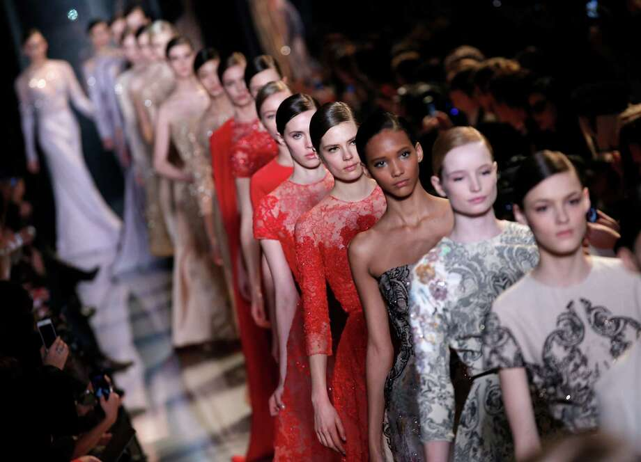 Models present creations by Lebanese fashion designer Elie Saab. Photo: AP
