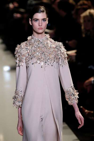 A model wears a creation by Lebanese fashion designer Elie Saab.