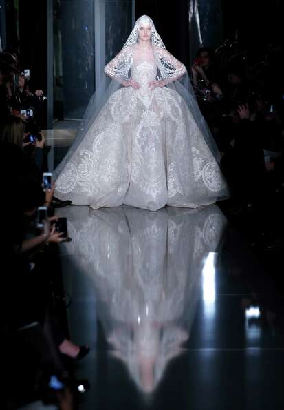 A model wears the wedding gown by Lebanese fashion designer Elie Saab.