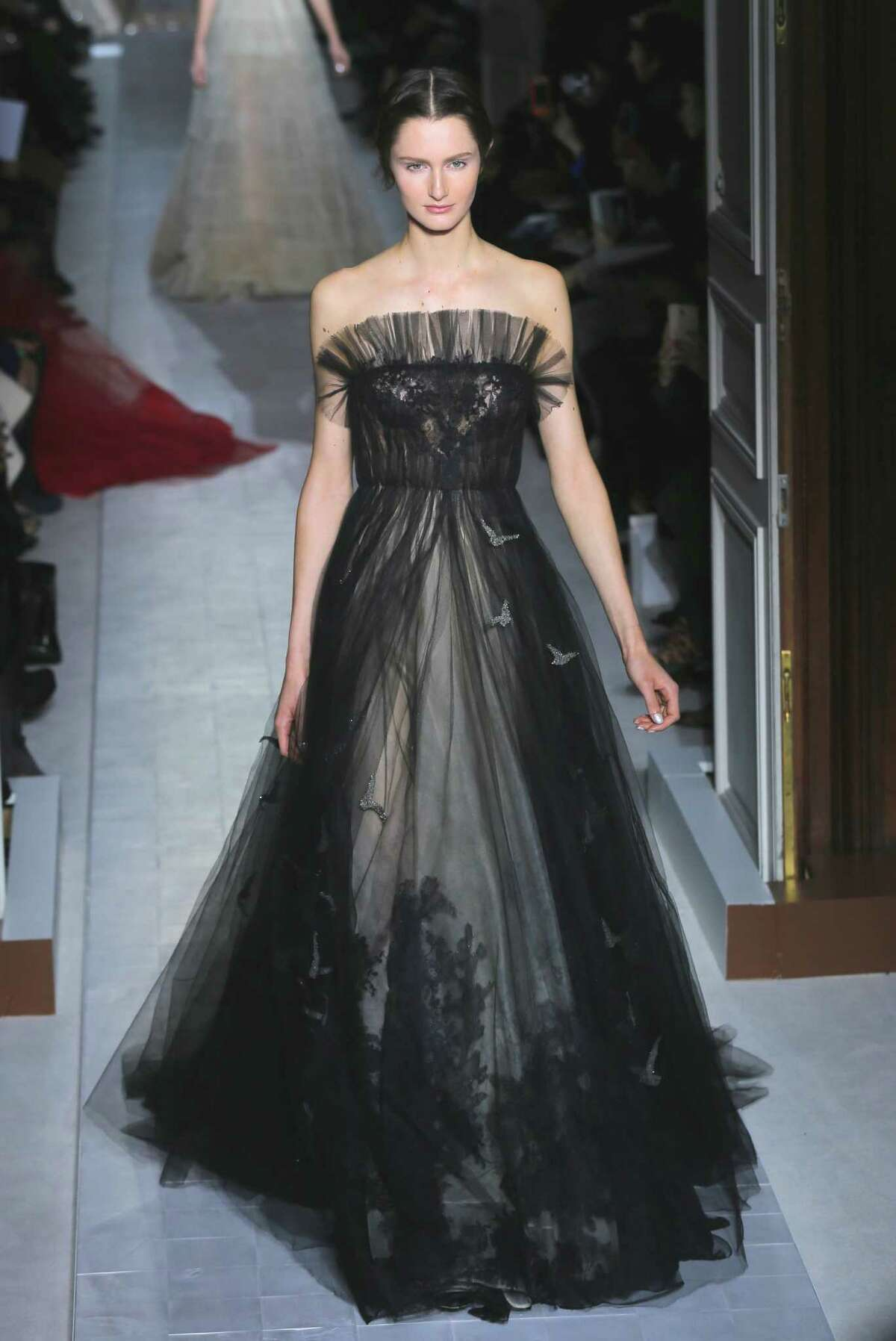 A model wears a creation by fashion designers Maria Grazia Chiuri and Pier Paolo Piccioli for Valentino.