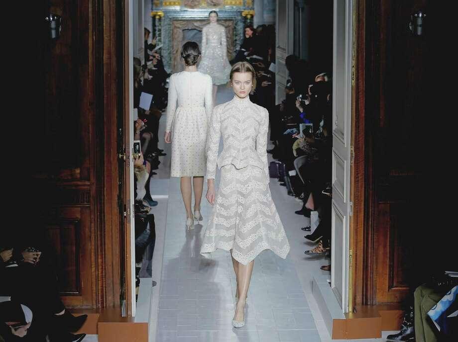 Models wear creations by fashion designers Maria Grazia Chiuri and Pier Paolo Piccioli for Valentino. Photo: AP