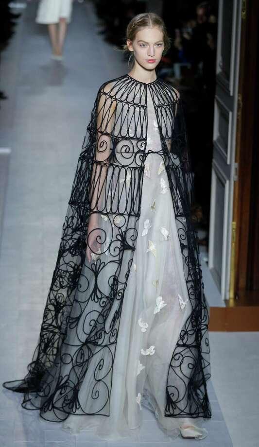 A model wears a creation by fashion designers Maria Grazia Chiuri and Pier Paolo Piccioli for Valentino. Photo: AP