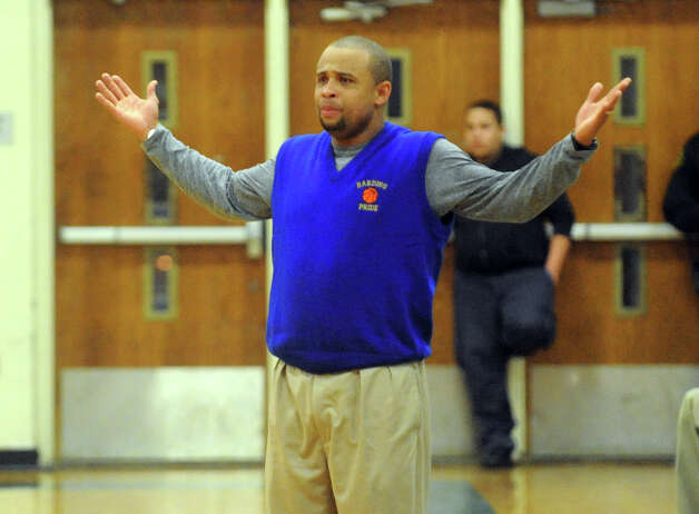 Harding Head Coach Charles Clemons, during boys basketball action against Trumbull in Bridgeport, Conn. on Wednesday February 15, 2012. Photo: Christian Abraham / Connecticut Post