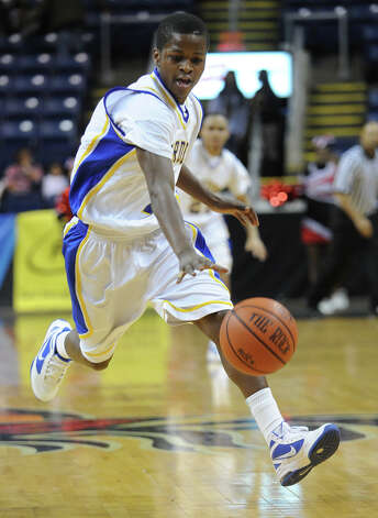 Harding's Terrance Rogers races the ball up the court during their matchup with Central at the Harbor Yard Classic at The Webster Bank Arena in Bridgeport on Monday, January 30, 2012. Photo: Brian A. Pounds / Connecticut Post
