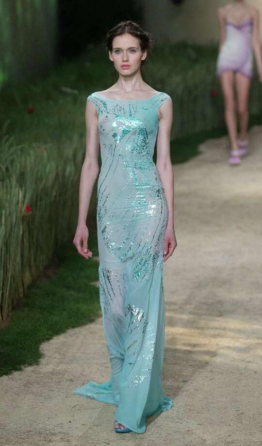 A model wears a creation by fashion designer Zahia. Photo: AP