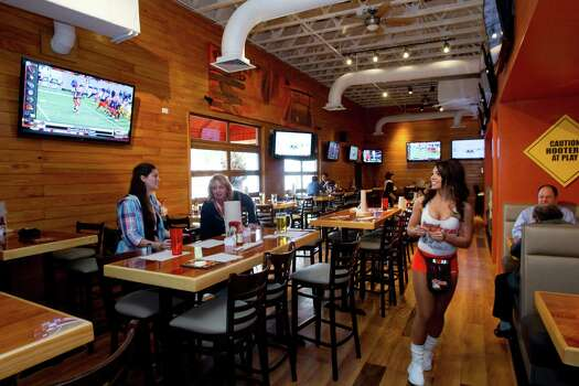 The interior of the renovated Hooters on Kirby  Photo: Brett Coomer, Houston Chronicle / © 2013 Houston Chronicle