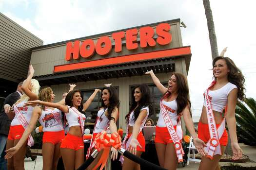 Hooters Girls announce the grand re-opening of the Hooters on the Southwest Freeway at Kirby on Wednesday. It's the first Hooters in Texas to get a total makeover. Photo: Brett Coomer, Houston Chronicle / © 2013 Houston Chronicle