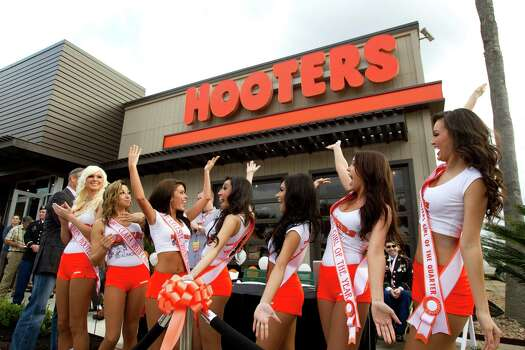 "This Hooters boasts ""sleek and contemporary finishes and a more comfortable dining experience."" But we're guessing that's not all that will draw customers. Photo: Brett Coomer, Houston Chronicle / © 2013 Houston Chronicle"