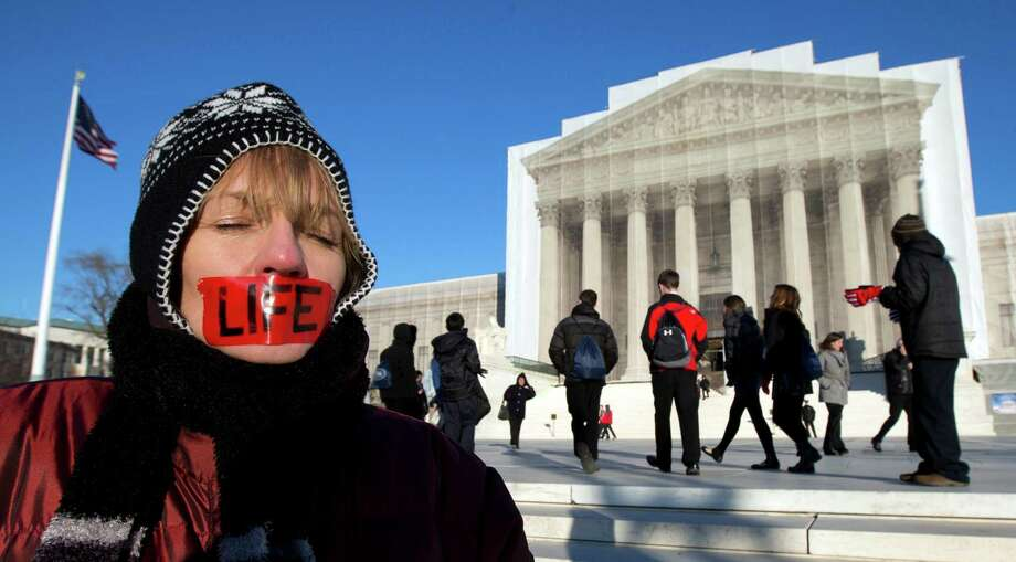 Anti-abortion activist, Jenese English, voices her opinion in front of the U.S. Supreme Court in Washington, Tuesday, Jan. 22, 2013 coinciding with the 40th anniversary of Roe v. Wade, the Supreme Court decision that legalized abortion.   (AP Photo/Manuel Balce Ceneta) Photo: Manuel Balce Ceneta, Associated Press / AP