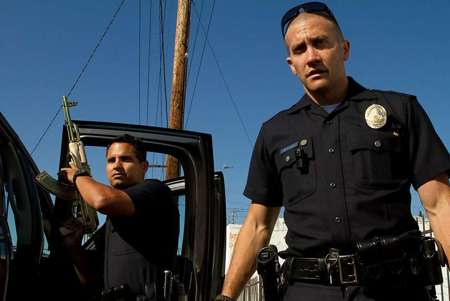 "Michael Peña (left) and Jake Gyllenhaal star as police officers in ""End of Watch,"" which features lots of wobbly-cam footage. Photo: Handout, McClatchy-Tribune News Service"