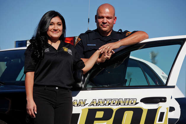 Wives on Duty founder and auxiliary SAPD Chaplain, Allison Uribe stands with her husband, SAPD officer Joe Uribe. Photo: Lisa Krantz, San Antonio Express-News / © 2012 San Antonio Express-News
