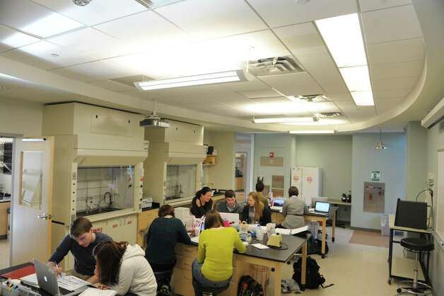 Students in professor Kristin Fox's biochemistry class work in one of the lab spaces inside the Wold Science/ Engineering Center on Wednesday, Jan. 23, 2013 in Schenectady, NY.  The building was certified as LEED Gold by the U.S. Green Building Council in 2012.  This lab uses daylight so that when the sun is out the room lights dim.   (Paul Buckowski / Times Union) Photo: Paul Buckowski  / 10020883A
