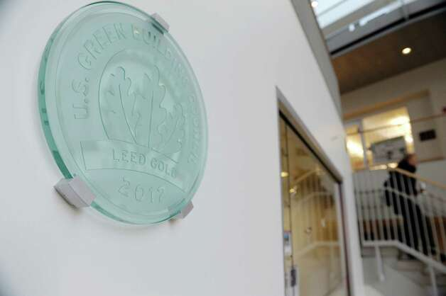 The LEED plaque seen on the wall inside the Wold Science/ Engineering Center on Wednesday, Jan. 23, 2013 in Schenectady, NY.  The building was certified as LEED Gold by the U.S. Green Building Council in 2012.   (Paul Buckowski / Times Union) Photo: Paul Buckowski