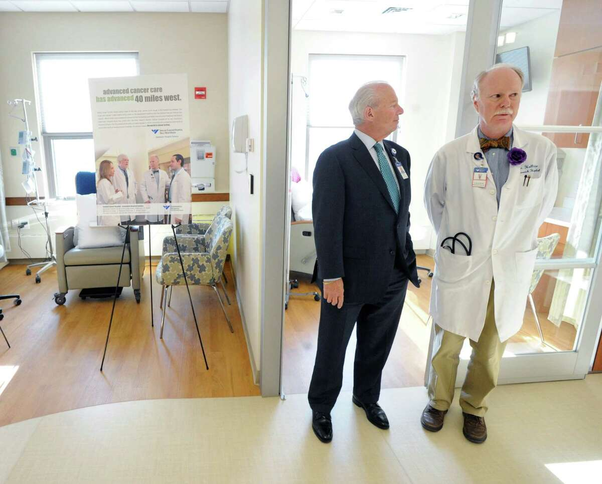 At left, Frank Corvino, president & CEO of Greenwich Hospital and Dickerman Hollister, Jr., medical director of the Bendheim Cancer Center, prior to the Greenwich Hospita/Yale New Haven Health ribbon-cutting ceremony to mark the opening of the newly renovated Bendheim Cancer Center at 77 Lafayette Place , Greenwich, Jan. 22, Tuesday afternoon, 2013.