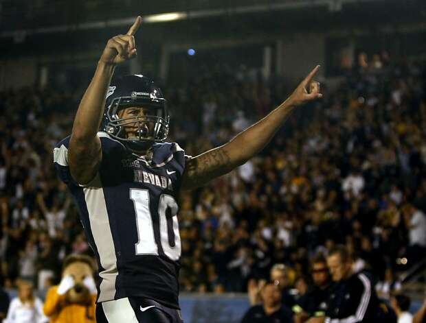 Nevada's Colin Kaepernick celebrates one his second touchdown in the first half of an NCAA college football game Friday, Sept. 17, 2010, The Wolf Pack defeated the Bears 52-31  in Reno, Nevada. The Wolf Pack defeated the Bears 52-31 Photo: Lance Iversen, The Chronicle