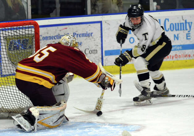 St. Joseph goalie Marc Van Etten deflects a shot attempt by Trumbull's #9 A.J. DiMasi, during hockey action in Shelton, Conn. on Wednesday January 23, 2013. Photo: Christian Abraham / Connecticut Post