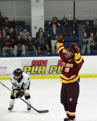 St. Joseph's #16 Vito Roca celebrates after scoring a goal against Trumbull, during hockey action in Shelton, Conn. on Wednesday January 23, 2013. Photo: Christian Abraham / Connecticut Post