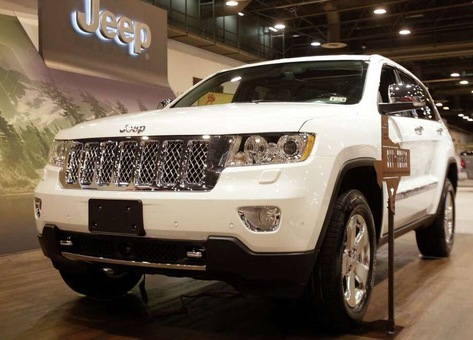 A Jeep Grand Cherokee shown at the Houston Auto Show in Reliant Center, Tuesday, Jan. 22, 2013, in Houston.  The show runs from Jan. 23 through Jan. 27. Photo: Melissa Phillip, Houston Chronicle / © 2013 Houston Chronicle