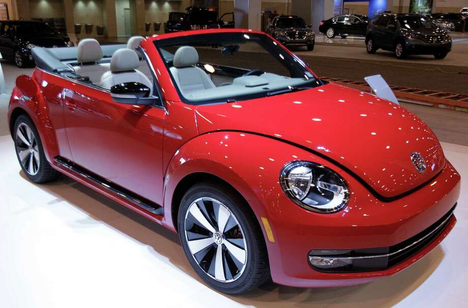 A VW Beetle convertible turbo shown at the Houston Auto Show in Reliant Center, Tuesday, Jan. 22, 2013, in Houston.  The show runs from Jan. 23 through Jan. 27. Photo: Melissa Phillip, Houston Chronicle / © 2013 Houston Chronicle