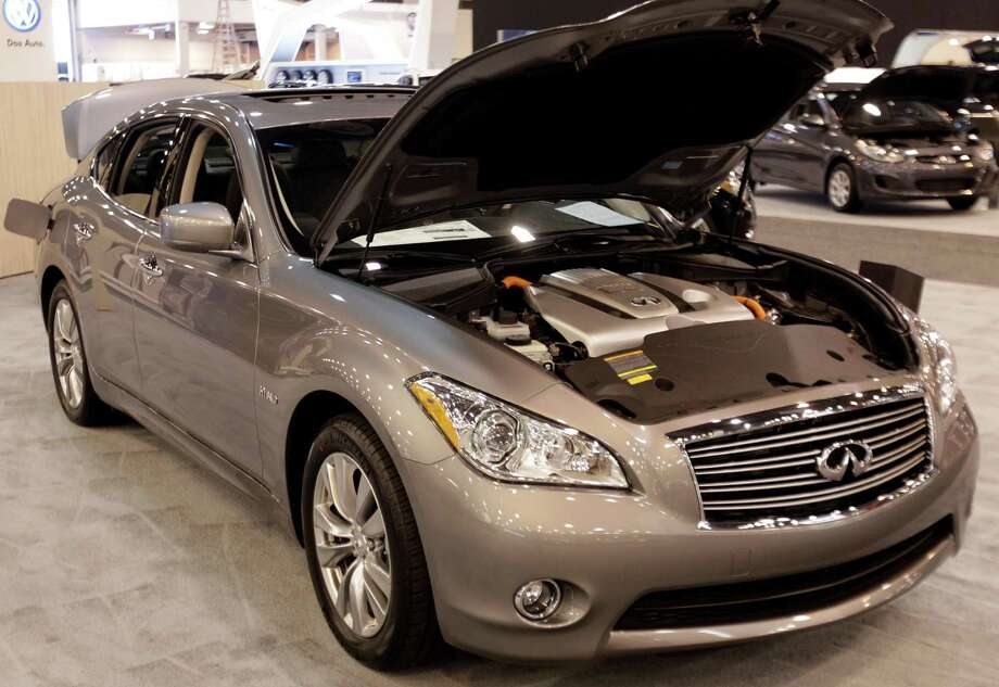 An Infiniti M Hybrid shown at the Houston Auto Show in Reliant Center, Tuesday, Jan. 22, 2013, in Houston.  The show runs from Jan. 23 through Jan. 27. Photo: Melissa Phillip, Houston Chronicle / © 2013 Houston Chronicle