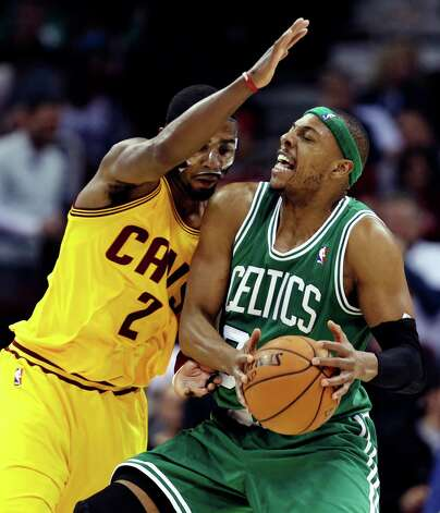 Boston Celtics' Paul Pierce, right, is stopped by Cleveland Cavaliers' Kyrie Irving during the second quarter of an NBA basketball game, Tuesday, Jan. 22, 2013, in Cleveland. (AP Photo/Tony Dejak) Photo: Tony Dejak