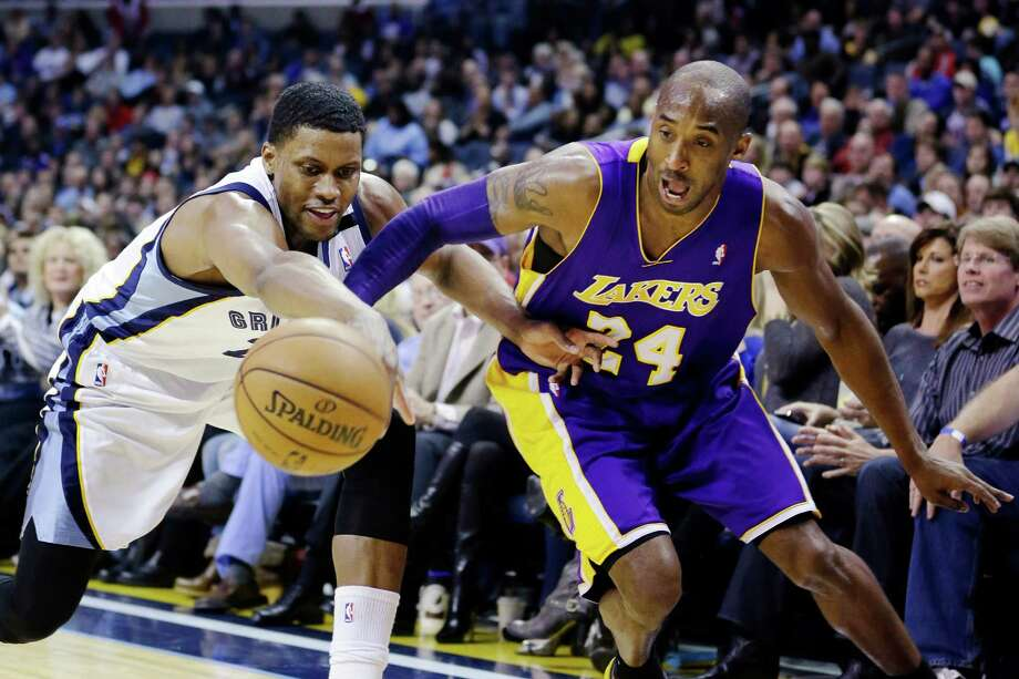 Memphis Grizzlies' Rudy Gay, left, and Los Angeles Lakers' Kobe Bryant (24) battle for a loose ball during first half of an NBA basketball game in Memphis, Tenn., Wednesday, Jan. 23, 2013. (AP Photo/Daniel Johnston) Photo: Daniel Johnston, Associated Press / AP