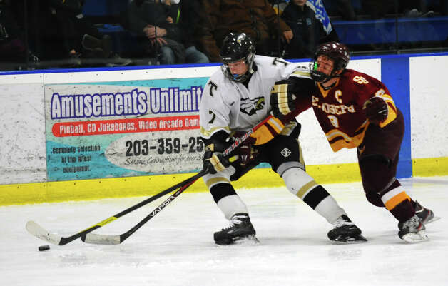 Trumbull's #7 Owen Polzello gets ahead of St. Joseph's #9 Christian Keator, for control of the puck, during hockey action in Shelton, Conn. on Wednesday January 23, 2013. Photo: Christian Abraham / Connecticut Post