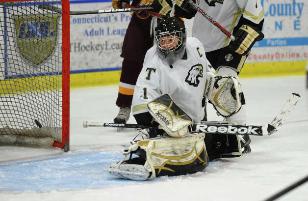 Trumbull's Matthew Paolini fails to stop a St. Joseph shot, during hockey action in Shelton, Conn. on Wednesday January 23, 2013. Photo: Christian Abraham / Connecticut Post