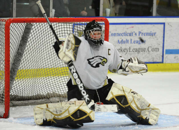 Trumbull's Matthew Paolini readies to deflect a St. Joseph shot, during hockey action in Shelton, Conn. on Wednesday January 23, 2013. Photo: Christian Abraham / Connecticut Post