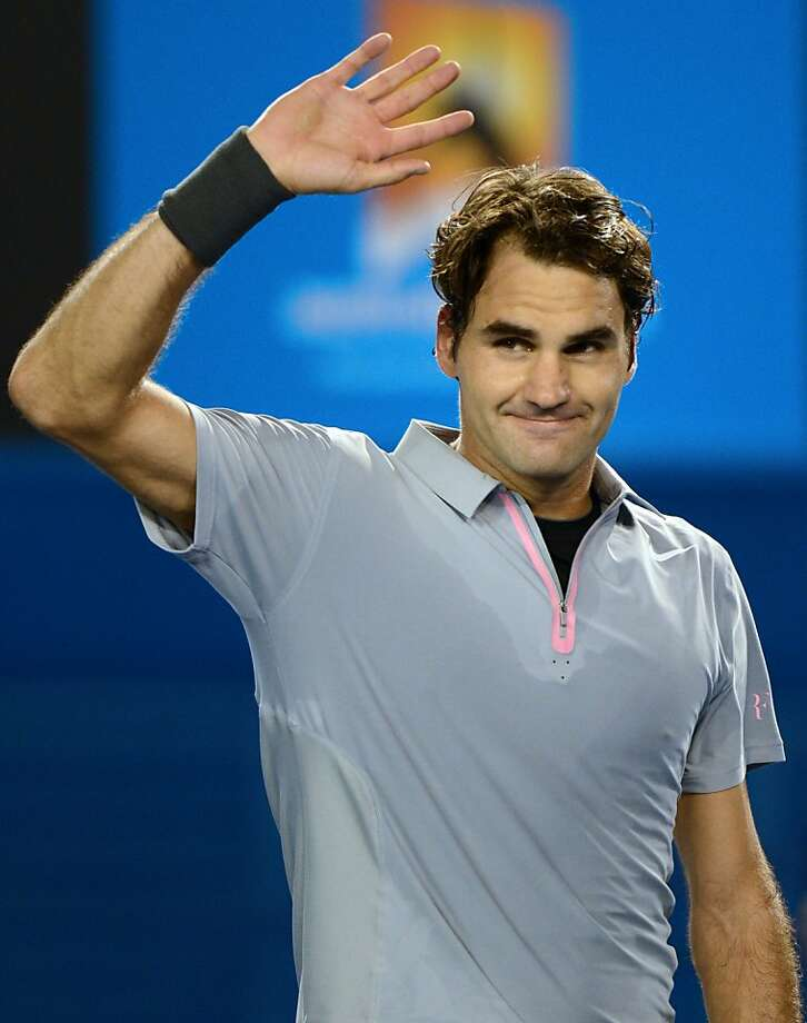 Roger Federer acknowledges the fans after his five-set win over Jo-Wilfried Tsonga. Photo: Greg Wood, AFP/Getty Images