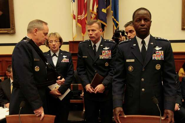 WASHINGTON, DC - January 23 - General Mark A. Welsh III, USAF, Chief of Staff, USAF at left and General Edward A. Rice, Jr., USAF, Commander, Air Education and Training Command, USAF, with staff, at hearing on review of sexual misconduct by basic training instructors at Lackland Air Force Base by House Armed Services Committee, 2118 Rayburn Building. Photo: Susan Biddle / Susan Biddle